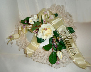 """Auntie"" on white satin ribbon with transparent borders."