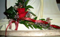 """Another look at """"Beloved Sister"""" gold on red satin ribbon."""