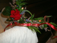 """""""Beloved Sister"""" in our plumage gold script atop a red, satin ribbon."""