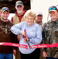 """Ozark Shooters Sports Complex"" on red satin ribbon."